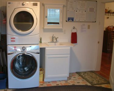 Laundry Room with washer, dryer, shower and sink