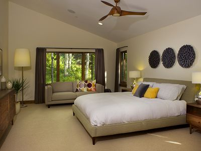 Master bedroom #1 with a king bed, sitting area and large, luxurious bathroom