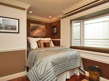 3rd upstairs Bedroom with full bed, window seat with view of lake