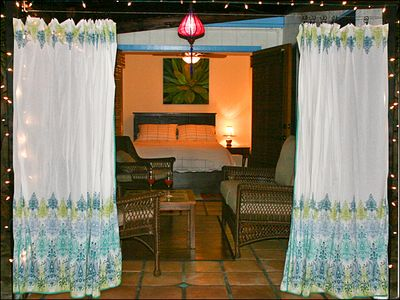 Cabana Room at dusk - encircled by curtains for extra privacy. Bedroom (back)