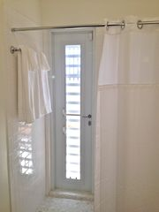Vieques Island villa photo - The master shower has a pebbled floor and a door to the private outside shower
