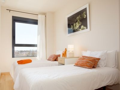 Twin bedroom overlooking the city