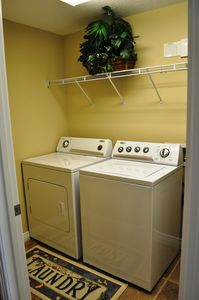 LAUNDRY ROOM WITH FULL SIZE WASHER & DRYER INSIDE OF THE CONDO