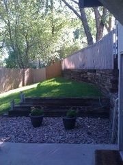 Manitou Springs townhome photo - Big fenced backyard, great for BBQ (provided), or enjoying the great CO weather!