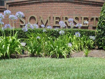 Flowered entrance to Sumerset Villas at the Remington Golf Community