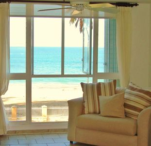 Living room with a ''Direct view to the White Sandy Beach''