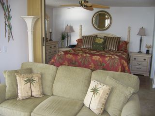 Fort Myers Beach condo photo - A queen sleeper/sofa is surrounded by beautiful water views.
