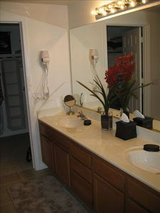 Large double vanity in Master Bath with large walk in closet.