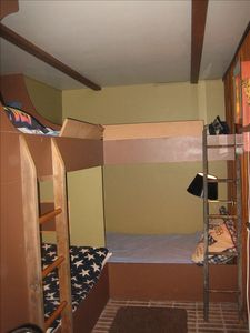 'Bunk Room' This room has 2 queen sized stacked beds and 2 stacked twin beds.