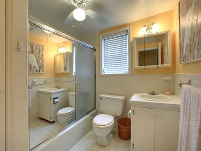 Roomy powder room with conveniently located adjacent washer & dryer.