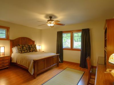 Charming guest bedroom with view of courtyard, pond and waterfall