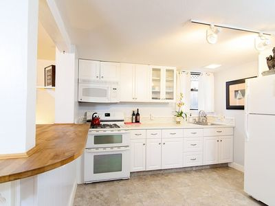 The kitchen features well stocked pantry, butcher block counters.