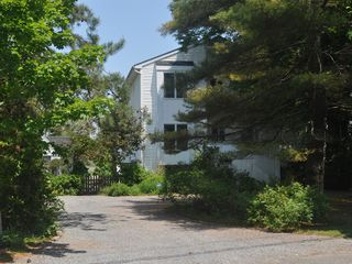 East Quogue house photo - View of Waterbird Watch, gravel driveway,and gate to garden from street.