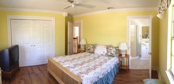 'Yellow Lily' bedroom with queen bed and private bathroom