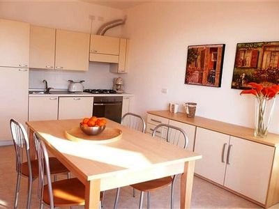 Le Vele Terrazzo ~ Fully-equipped kitchen with stylish dining area