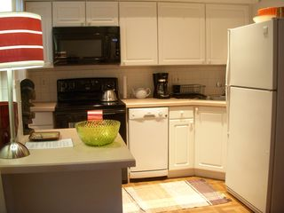 Boston condo photo - fully applianced kitchen, with new stove, microwave, dishwasher, coffee maker...