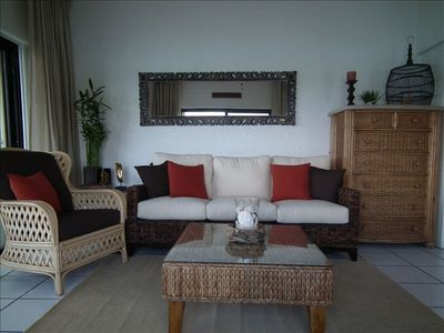 Contemporary island style furnishings with an asian flare.