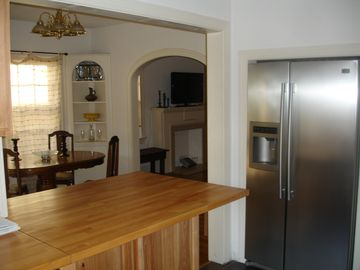 breakfast bar looking into dining room, modern side by side fridge