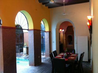 San Juan villa photo - Dining area with view of Kitchen Brick Stovetop area