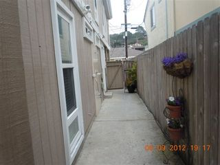 Del Mar condo photo - walkway from parking in car port off Sand Barr Alley and shower