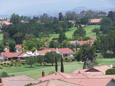 Breathtaking views of greenbelt, hills, mountains, and golf course.