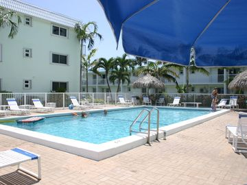 Our Large Heated Pool with lounge chairs & tiki tables