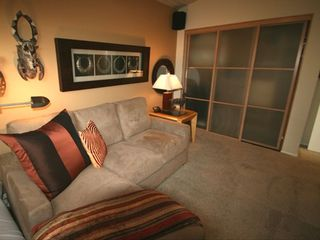 media/bedroom with Pioneer Elite plazma serround sound system. Couch queen bed.