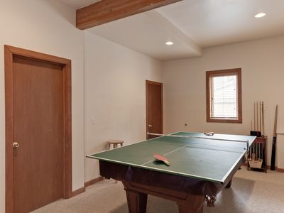 Pool room. Door on left to ski room, second door to double bunk room.