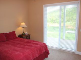 La Follette house photo - Queen bed with a walkout porch and beautiful view.