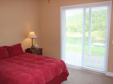 Queen bed with a walkout porch and beautiful view.