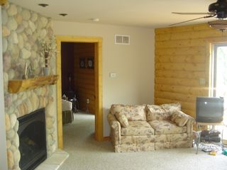 "Cedar Lake cabin photo - 2nd floor family room views the lake and features a fireplace, couch and 27"" TV"