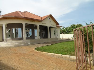 Front of house with veranda and yard