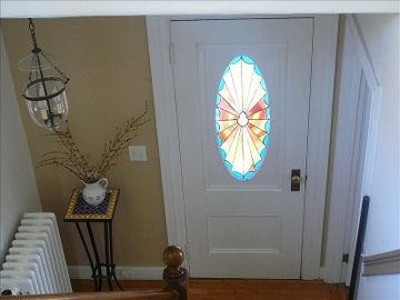 Front entry with custom stained glass