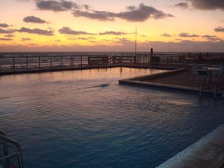 New Smyrna Beach condo photo - Sunrise over the pool