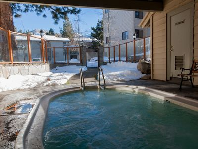 Relax after a day of outdoor activities in the large scenic hot tub on premises