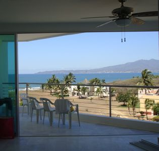 Watch the ocean all day long. View of 1st balcony from main living area.