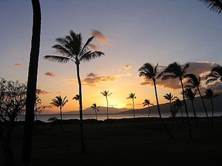 Kihei condo photo - A beautiful Maui sunset from the pool and jacuzzi on property.