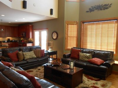 Leather sofas, wood floors, high ceilings