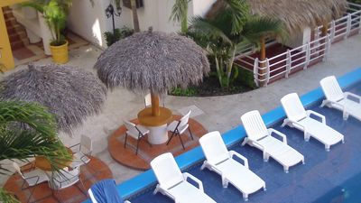 Chairs & Palapas around the pool.