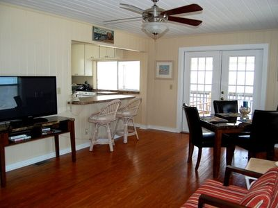 Alligator Point cottage rental - View from living room to dining area, kitchen and screened in porch behind that.
