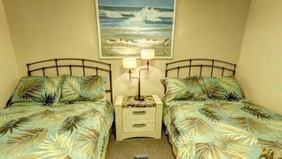Indian Rocks Beach condo photo - Guest Bedroom w/ two double beds, full closet, bureau & flat screen TV.