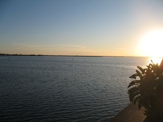 Cocoa Beach condo photo - Enjoy the sunset from your private balcony or take a walk on the dock below!