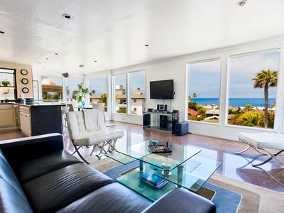 Lounge seating inspired living area and open floor plan featuring amazing coastal views.