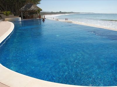 OUR HUGE INFINITY POOL IS TRULY RIGHT ON THE BEACH!