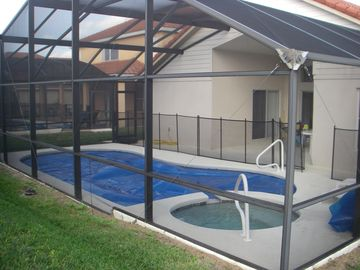 another view of the pool and back patio