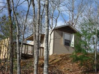 .Cabin is cute. Shutters are made to look part open. Full deck with nice views