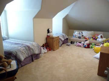 Bedroom 3 upstairs: Children's room, 2 twins + 1 futon + 1 FULL BED (not shown)
