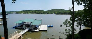 Dock, large swim deck, 2 boat slips, and 4 pwc lifts. water trampoline