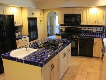 West Coast Villa Luxury Vacation Rental. Large kitchen with island