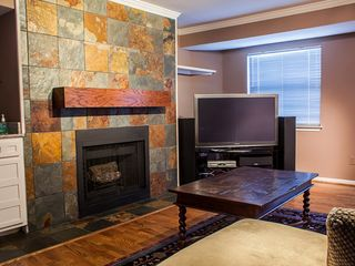 Austin condo photo - Living room with wetbar, gas fireplace, and huge TV w/Blu-Ray Player and cable.